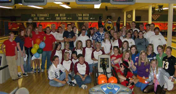 A large group of students at the bowling alley.
